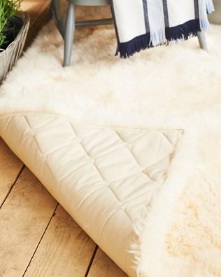 7480-padded sheepskin rug-under.jpg