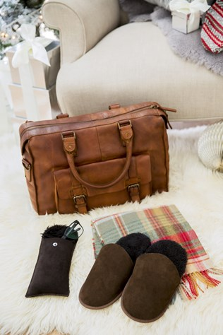 leather holdall bag £198, sheepskin glasses case £16, lambswool tartan scarf £35, sheepskin scuffs £42, pictured on sheepskin rug_quad £345.jpg