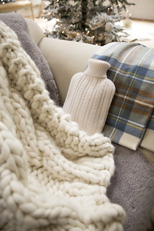 cashmere hot water bottle cover £95 pictured with chunky cable throw £395, lambswool tartan throw £150 and sheepskin throw £410.jpg