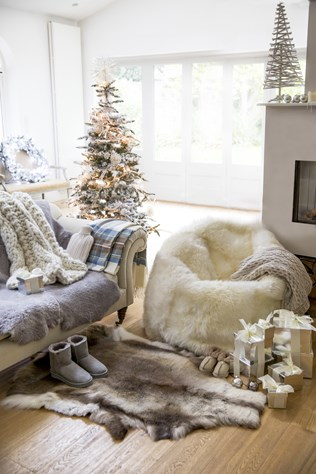 sheepskin beanbag £875, cable plaited blanket £78, nordic rug £255, coloured shortie boots £125, kids bootee slippers £35, chunky cable throw £395, sheepskin throw £410, cashmere hot water bottle £95.jpg