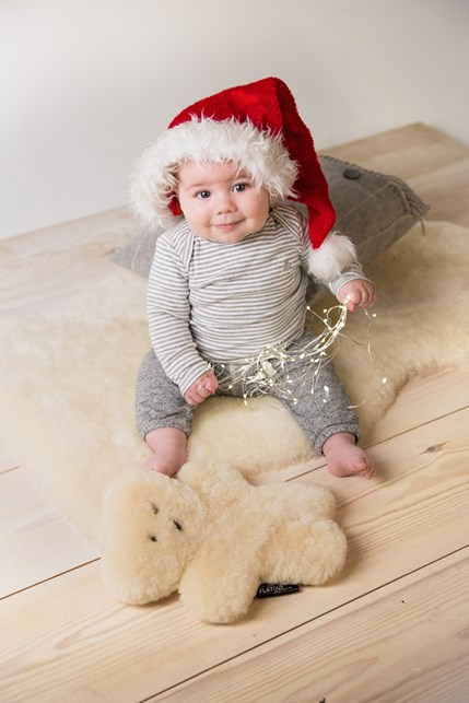 flatout bear £58, infant fleece £84, merino cushion £55.jpg