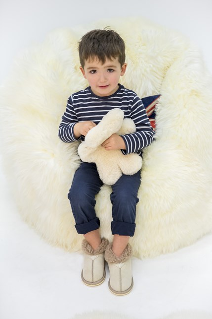 kids sheepskin bootee slippers £35 pictured with, sheepskin beanbag £875, flatout bear £58.jpg