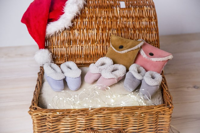 sheepskin pram shoes £20, sheepskin purse £22, pictured on infant fleece £84.jpg